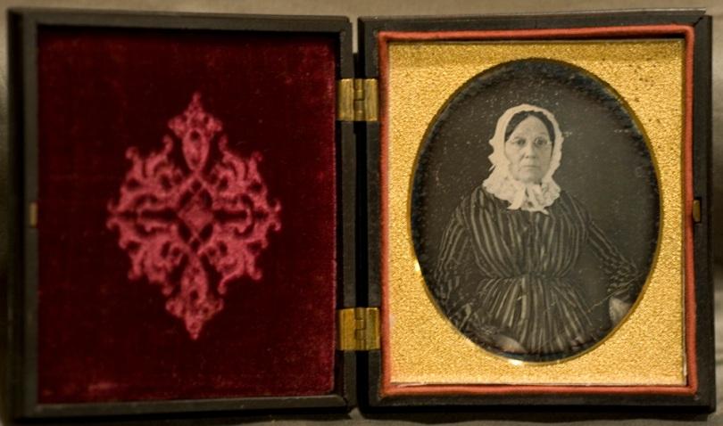 Sixth Plate Daguerreotype in Union case, anonymous lady in bonnet