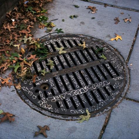 Graffiti-inscribed Manhole Cover