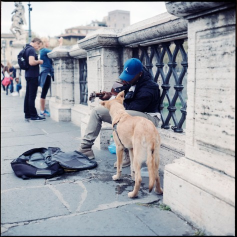 Busker and dog, Angel Bridge